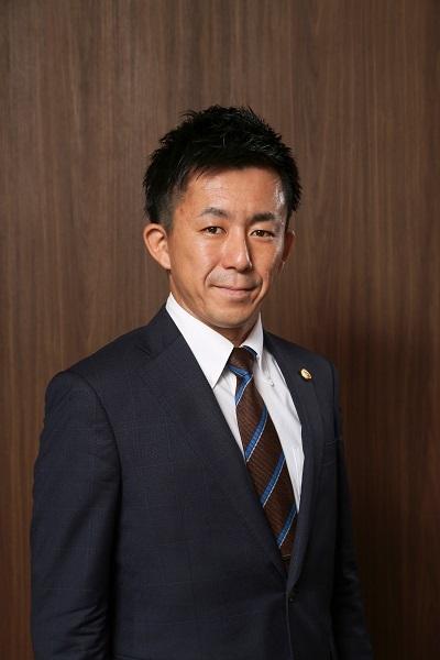 古結先生プロフィール写真(DK用縮小).jpg